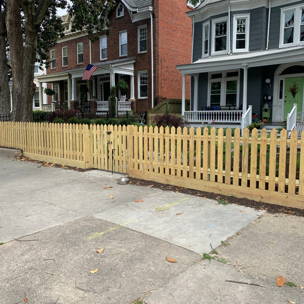 4 foot high 45 degree pointed wood picket fence.