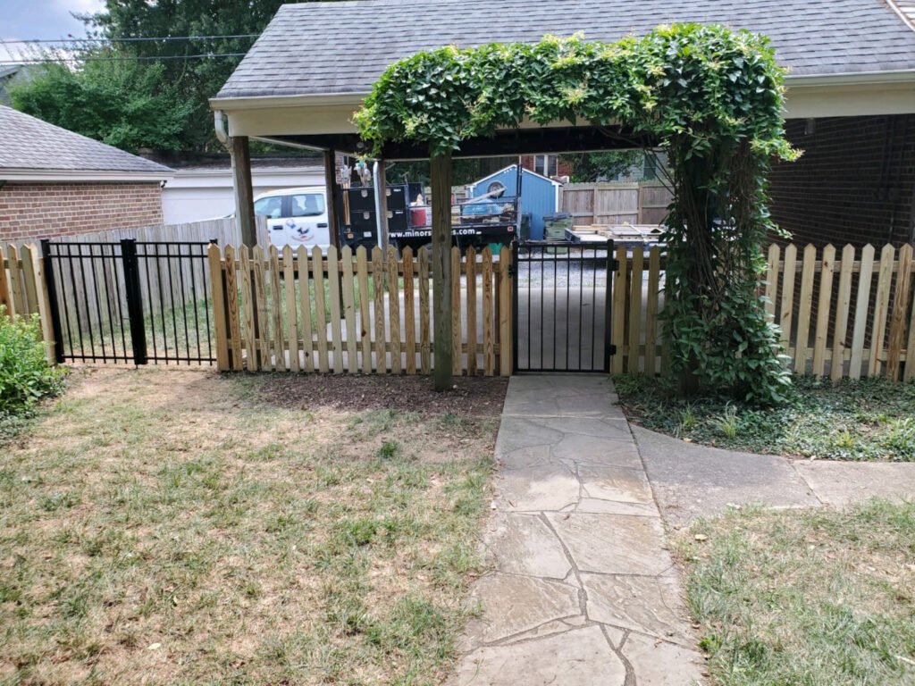 Four foot 45 degree pointed picket fence with aluminum gates.