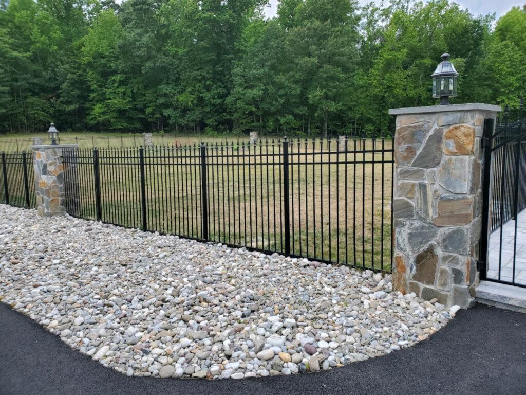Five foot high series-b 3-rail black aluminum fence with quad finals.