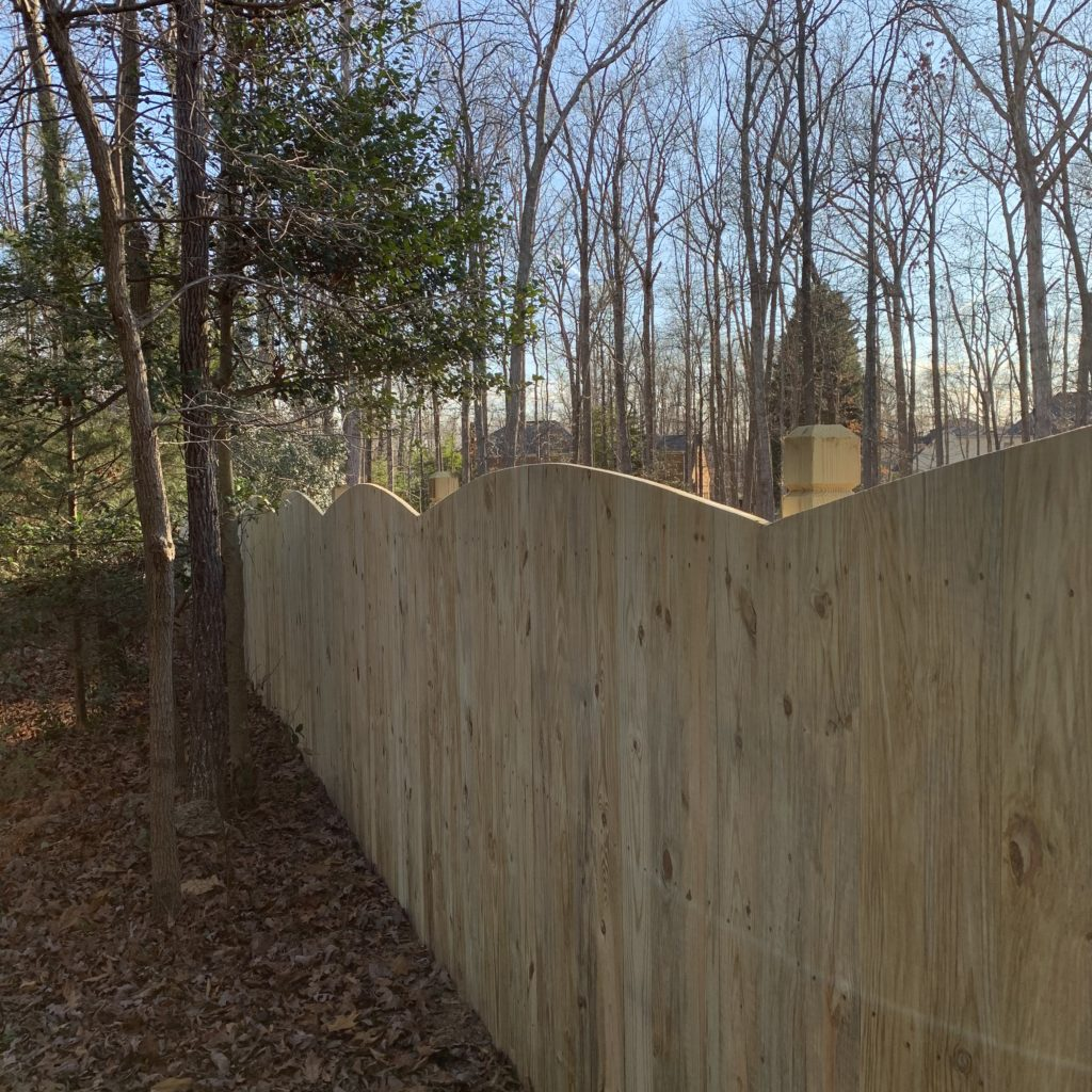 Six foot convex privacy fence with beveled and notched posts.