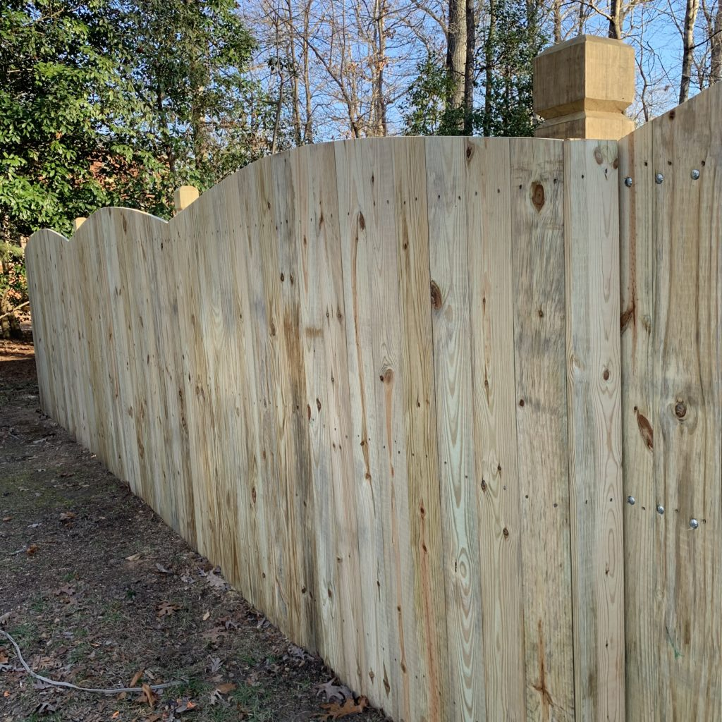 6 foot wood privacy fence with beveled and notched posts.