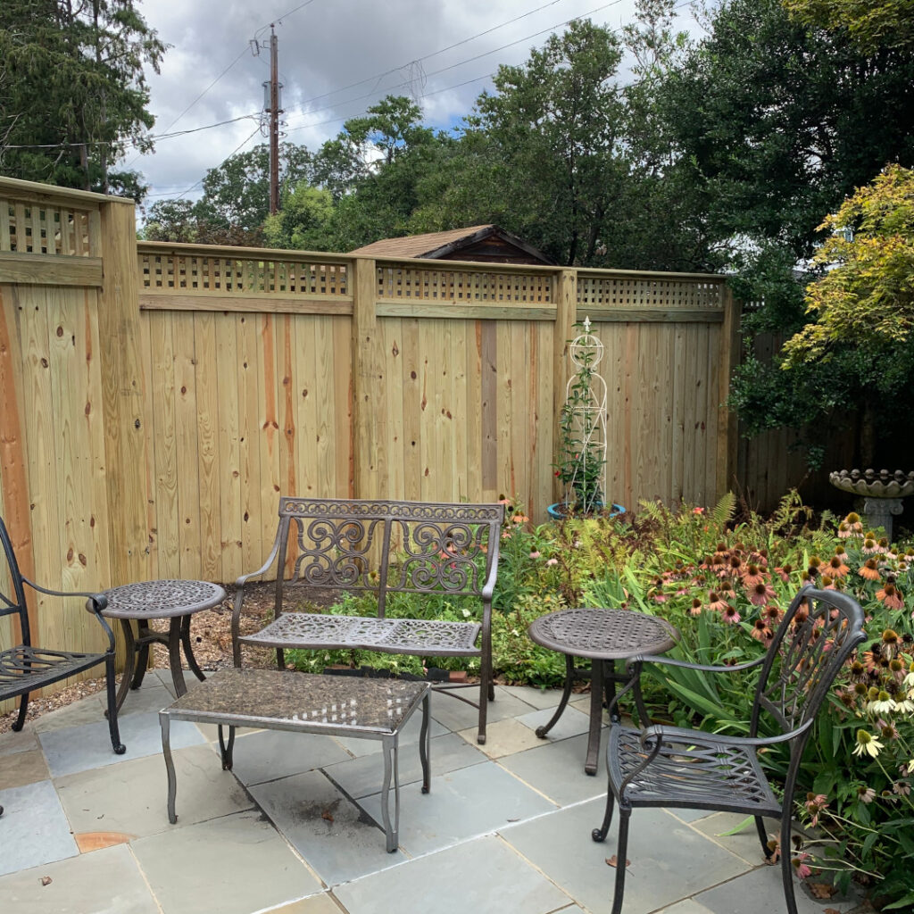 """7' 7"""" tall wood privacy fence with horizontal lattice."""