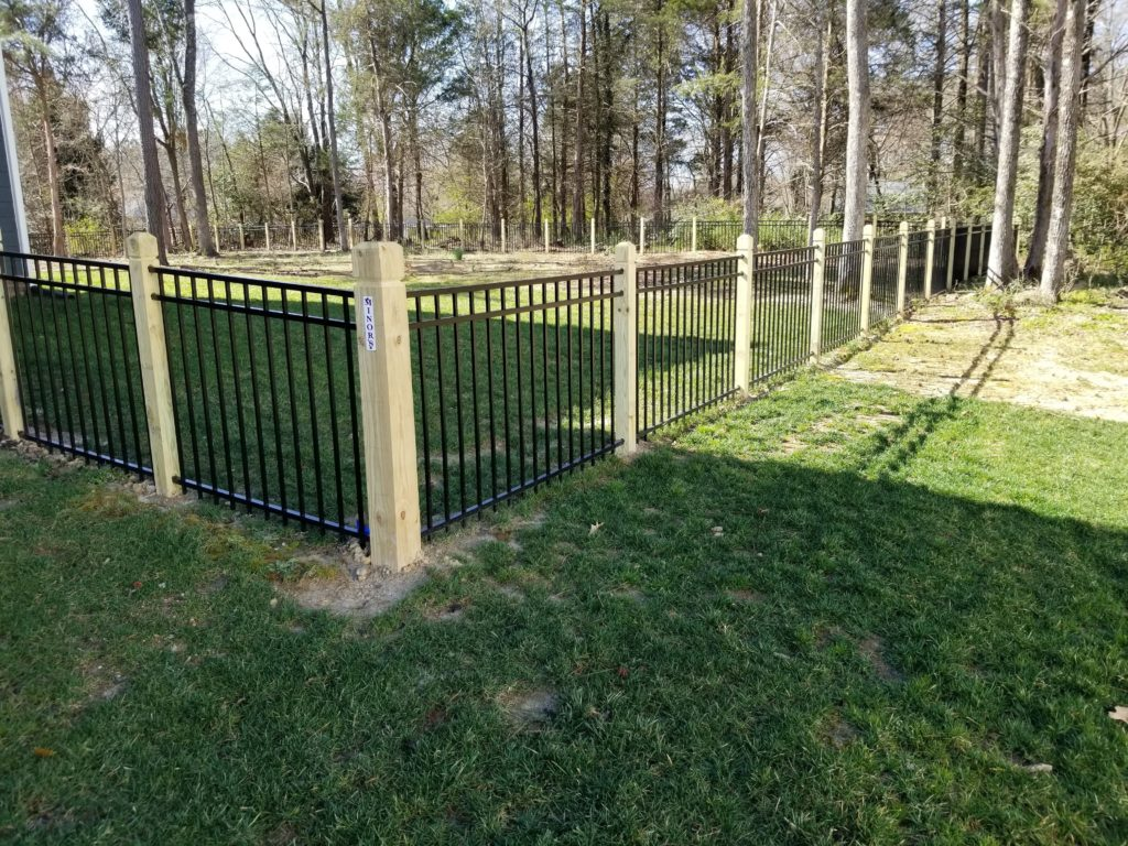 aluminum fencing with beveled and notched wood posts