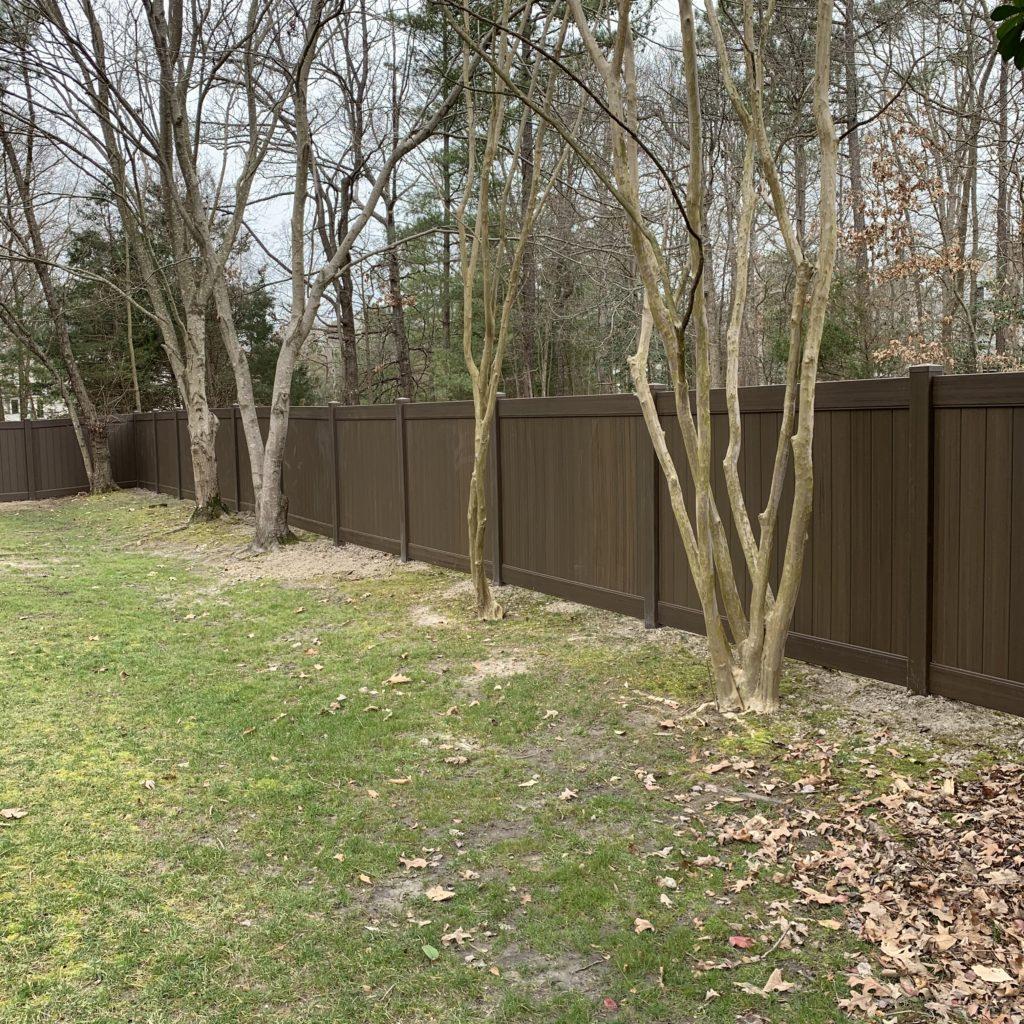 Chestnut brown vinyl privacy fence