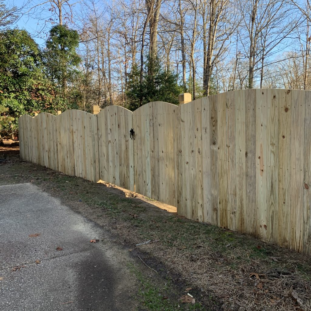 Convex wood privacy fence on beveled and notched posts