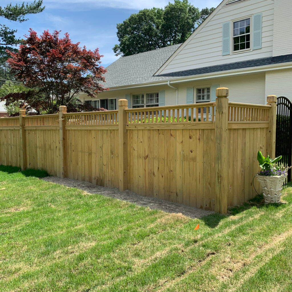6 foot high wood privacy fence with flat top pickets and 6 by 6 beveled and notched posts.