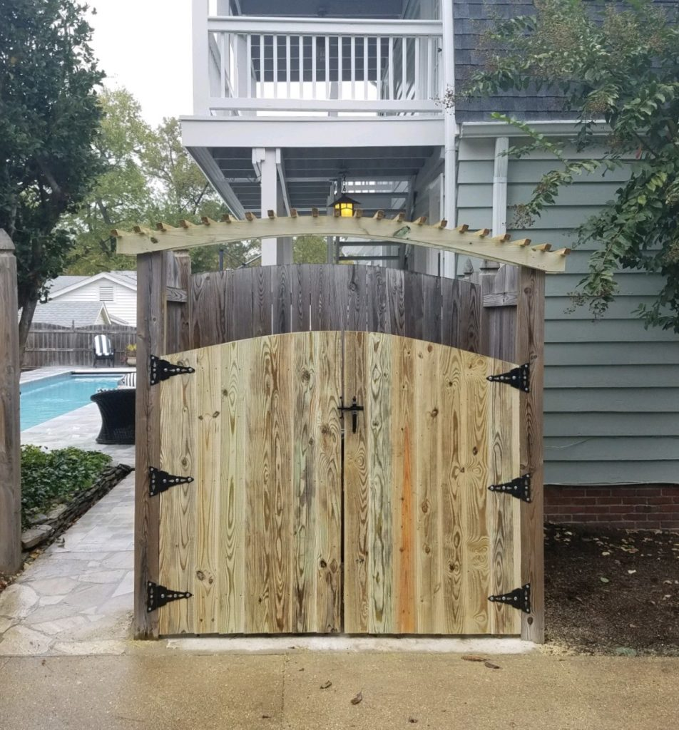 Privacy trash enclosure with arbor