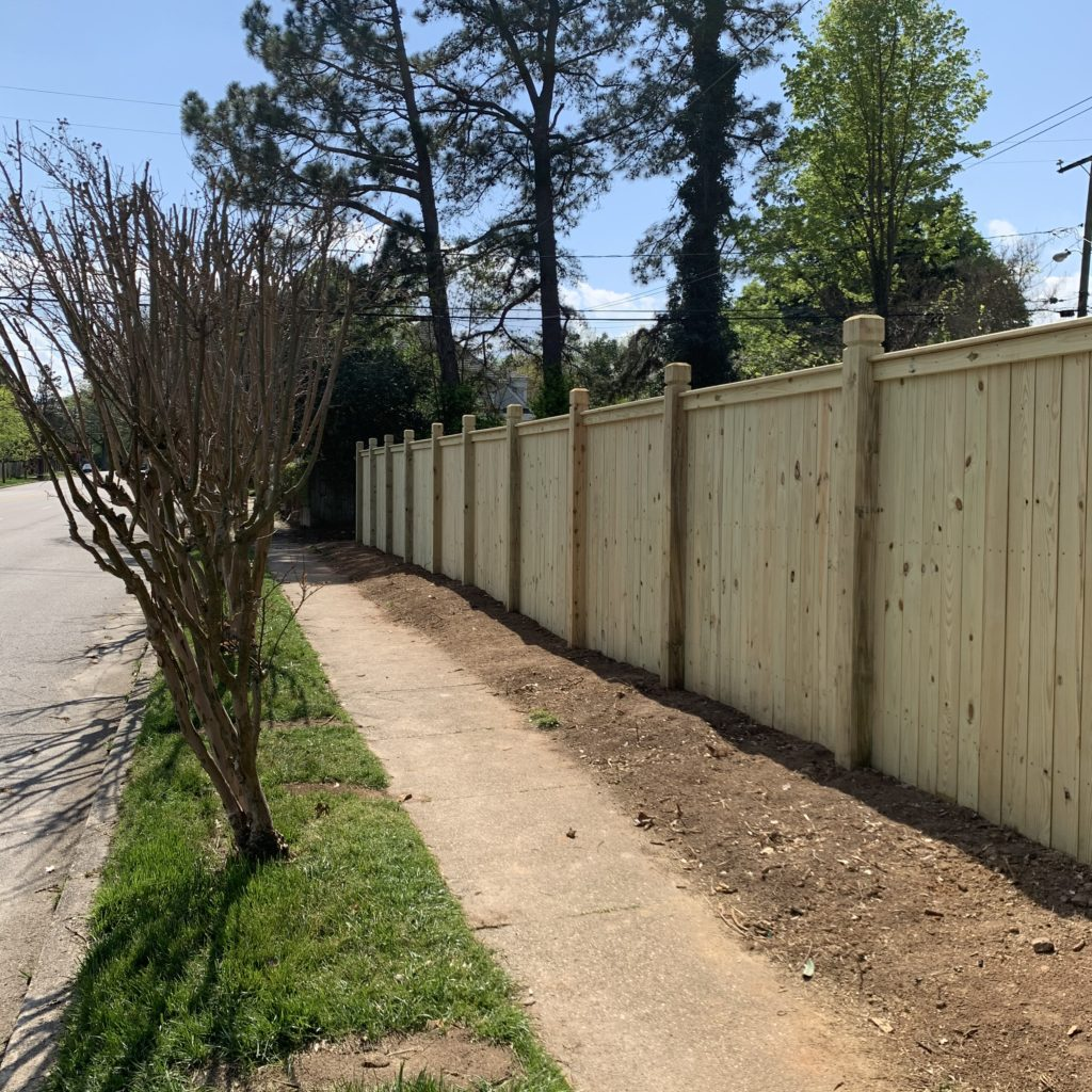 wood privacy fence with exposed 6×6 posts